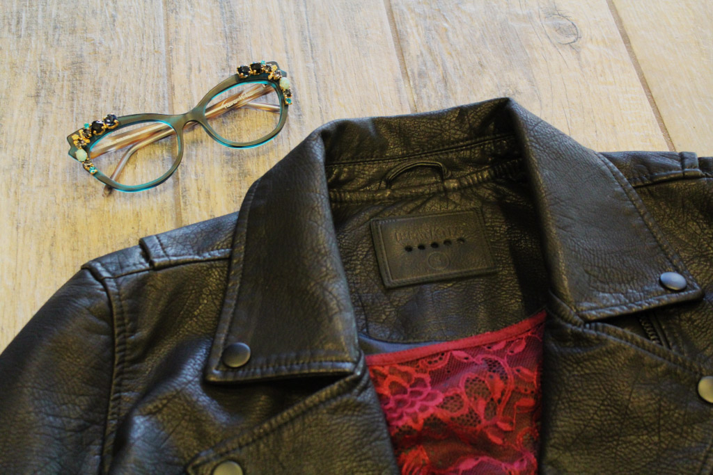 Black leather jacket and jeweled green frames