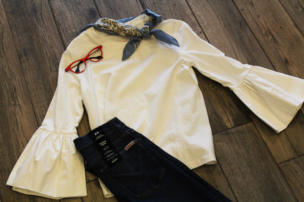 White shirt with black jeans and red frames